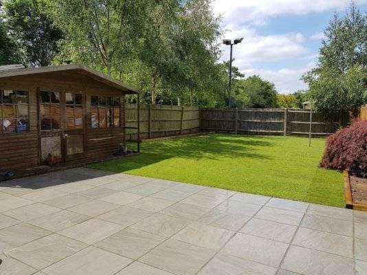 Light grey patio, sandstone sussex Patio Installation